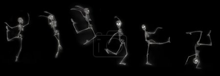 Photo for Silly dancing medical skeleton on xray machine - Royalty Free Image