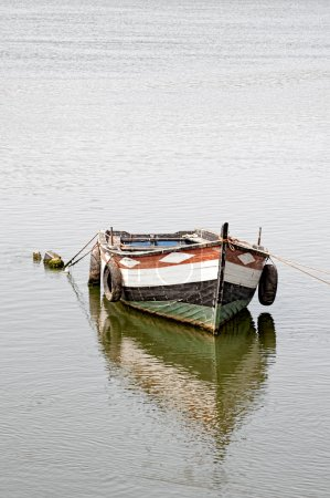 Traditional wooden fishing boat on water