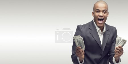 Photo for Successful young african businessman standing over gray background - Royalty Free Image