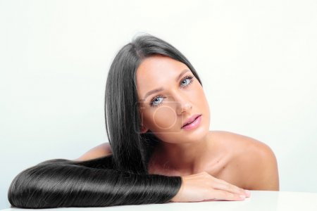 Beautiful girl with shiny black hair