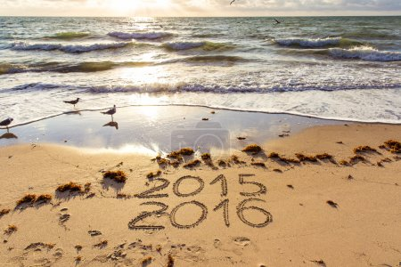 2015 and 2016 signs on a beach sand