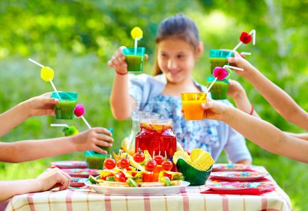 colorful picnic table with group of kids around