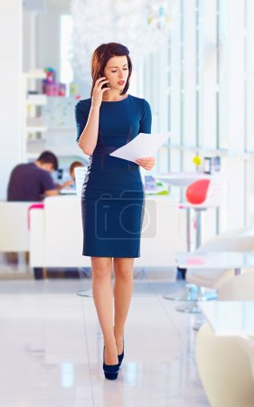 confident business woman busy with work