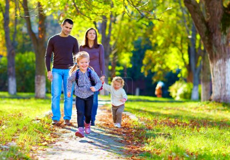 Photo for Happy family on walk in park - Royalty Free Image