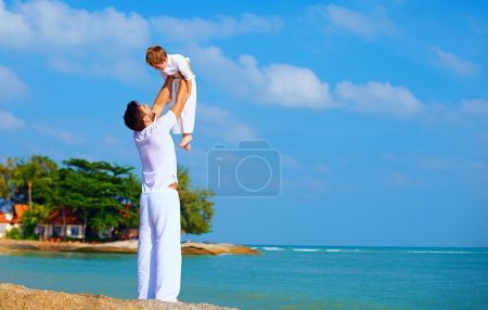 happy father and son enjoy life on tropical island