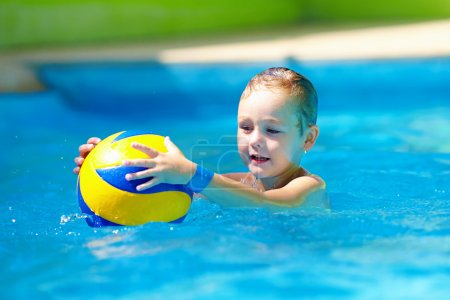 Photo for Cute kid playing water sport games in pool - Royalty Free Image