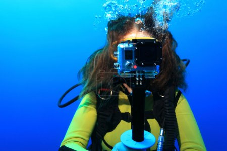 Scuba diver with action camera
