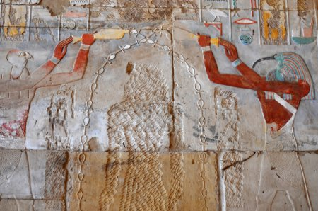 The Gods thoth and horus anointing the defaced ima...