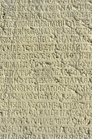 Photo for Ancient greek inscription on white weathered stone - Royalty Free Image