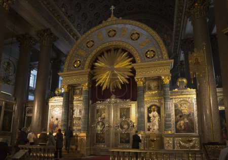 Worshippers pray at Kazan Mother of God. Kazan Cathedral in St. Petersburg, Russia