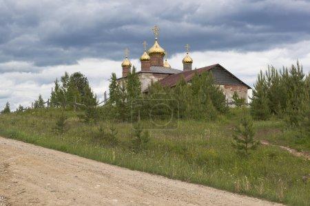 New domes on restorative church of St. Nicholas. Village Average (Olyushin) Verhovazhskogo district, Vologda region, Russia