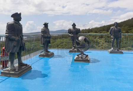 Sculptures travelers in maritime museum safari park in resort town Gelendzhik, Krasnodar Region, Russia