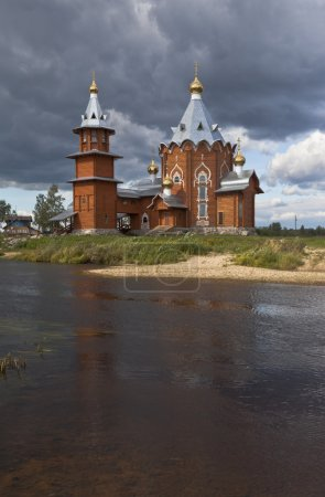 Wooden church on the banks rivers Pezhma. Church of the Nativity of Prophet and Forerunner John the Baptist in a village Zaruchevnya (Shilovskaya), Velsky district, Arkhangelsk region, Russia