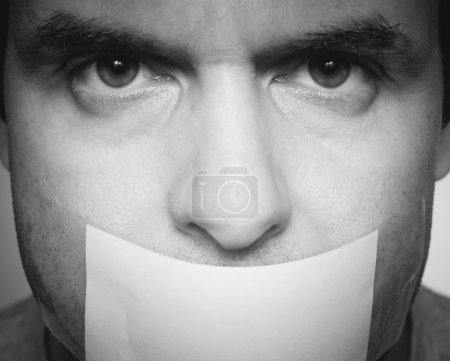 Caucasian man with duct tape on mouth, white .