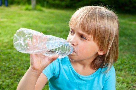 Child drinking water outdoor