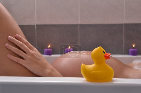 Photo for Serene pregnant woman in relaxing candle ambient at bathtub before give Birth. Beautiful young pregnant woman at beauty salon spa getting a body treatment. - Royalty Free Image