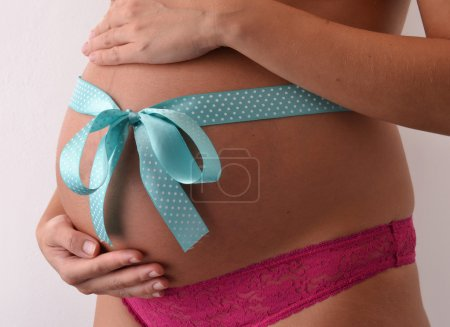 Pregnant woman with blue loop on her belly