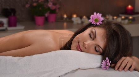 woman lying down in  beauty center