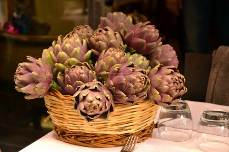 Artichokes on wood table