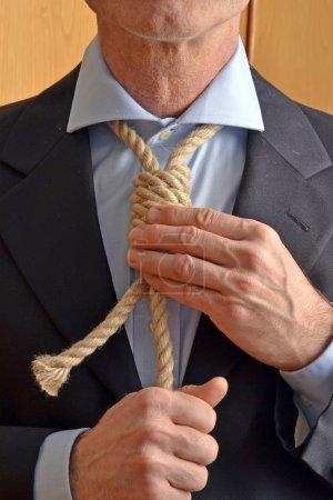 Hangman adjusting a noose rope
