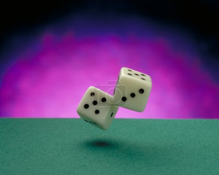 Throwing dices on casino felt.