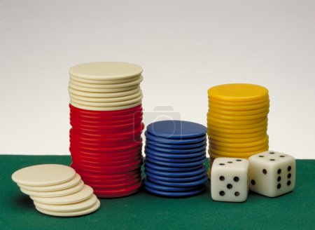 Poker Chips on a gaming table.