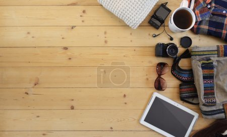 Hipster vintage accessories on a wooden background