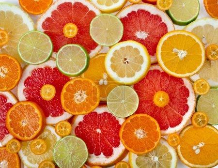 Photo pour Tranches colorées agrumes vue de dessus texture de surface gros plan - image libre de droit