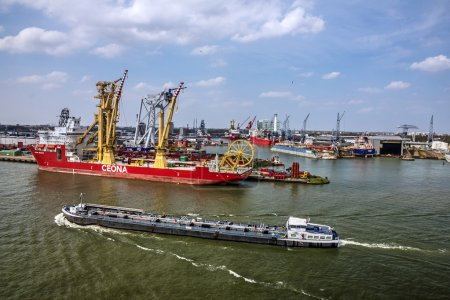 ROTTERDAM, NETHERLANDS - JUL 4, 2016: Cargo vessel in sea port Rotterdam, Netherlands.