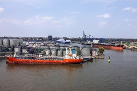 ROTTERDAM, NETHERLANDS - JULY 5, 2016: Cargo vessel in sea port Rotterdam, Netherlands.