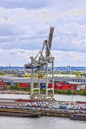 ROTTERDAM, NETHERLANDS - JULY 4, 2016: Port crane in Rotterdam, Netherlands, cargo terminals in sea por