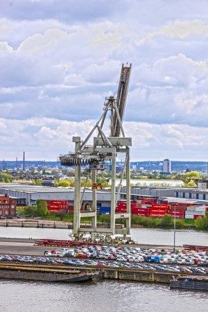 ROTTERDAM, NETHERLANDS - JULY 4, 2016: Port crane in Rotterdam, Netherlands, cargo terminals in sea por