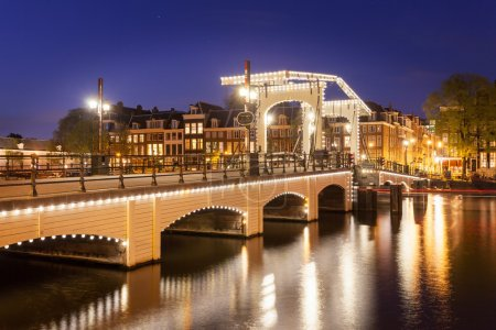 Skinny bridge on canal in Amsterdam,