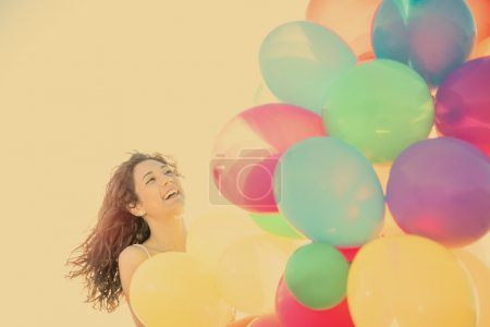 woman laughing having fun in vacation holidays warm filter appli