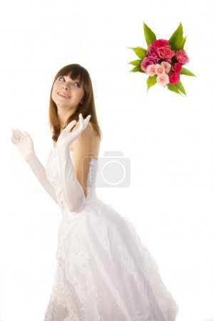 beautiful bride tossing bouquet