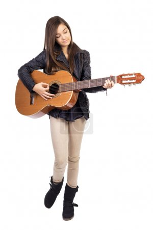 Photo for Beautiful teenager playing guitar  isolated on white background - Royalty Free Image