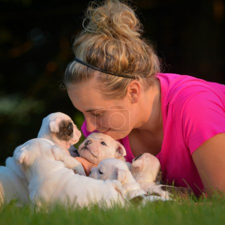 Woman and litter of puppies