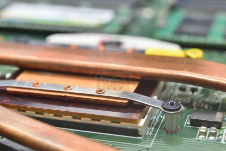 Photo for Mounting radiator for cpu on motebook matherboard - Royalty Free Image