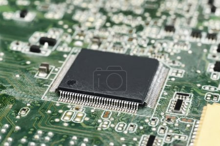 Photo for Chip on motherboard (mainboard) with controllers, ports and wires - Royalty Free Image
