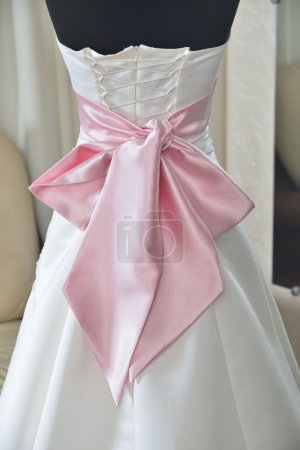 wedding dress with pink bow and corset