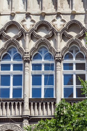 Windows of beautiful old Art Nouveau building in Budapest, Hunga