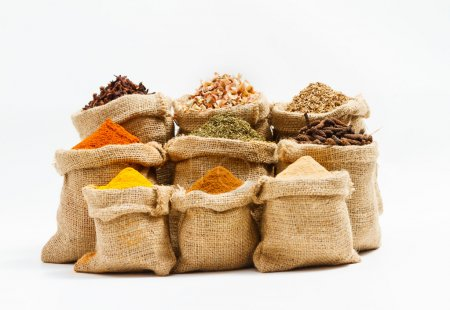 Photo for Spices and herb for cooking background and design,Top view spics and herbs on white background,spices content,spices background,Group of indian spices on white background with copy space. - Royalty Free Image