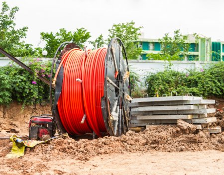 Photo for Spool of cable and fiber optics in the road background. - Royalty Free Image