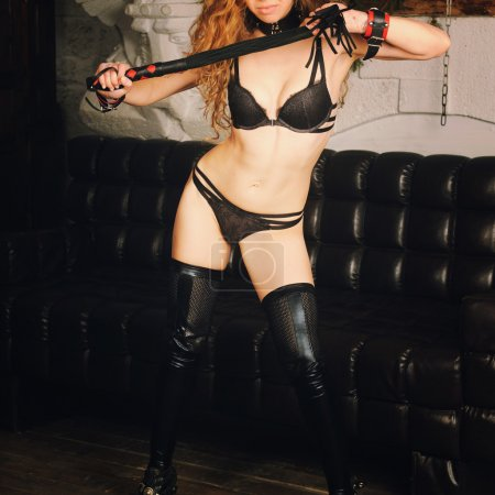Sexy woman body in handcuffs, black lingerie
