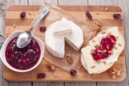 Bread served with camembert and cranberry...