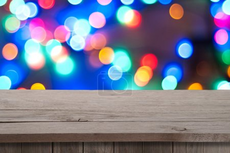 Photo for Christmas holiday or party background with empty wooden deck table over festive bokeh. Ready for product montage - Royalty Free Image
