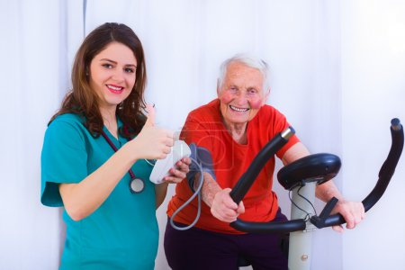 Elderly woman training, making effort