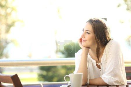 Pensive happy woman remembering