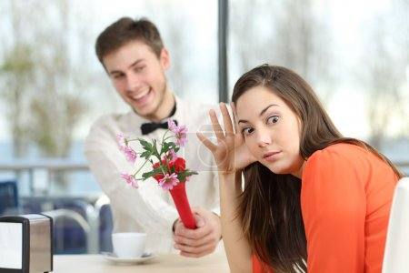Woman rejecting a geek boy in a blind date