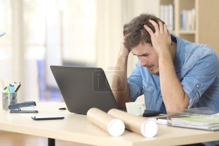 Sad entrepreneur worried about bad news